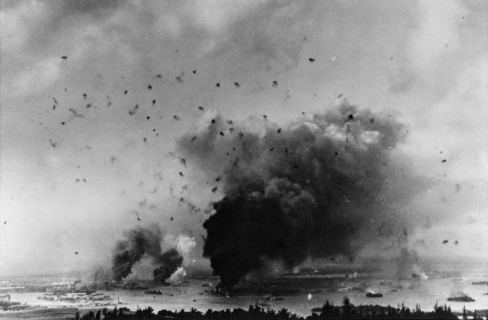 antiaircraft-bursts-dot-the-sky-above-smoking-ships-in-pearl-harbor