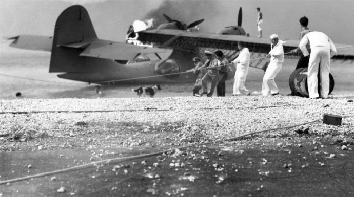 sailors-at-naval-air-station-kaneohe-hawaii-attempt-to-salvage-a-burning-pby-catalina-in-the-aftermath-of-the-japanese-attack-on-pearl-harbor